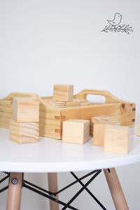 Wooden box containing wooden blocks on a scandi styled table
