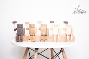 Line of wooden robot men with hammers in the air