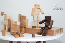 Load image into Gallery viewer, Wooden Robots posed on a piece of wood