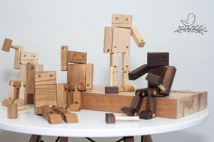 Wooden Robots posed on a piece of wood