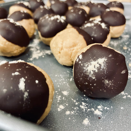 Chocolate dipped peanut butter protein balls