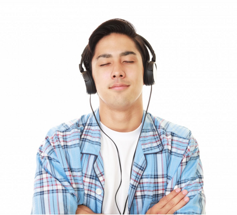 Man enjoys music with noise-cancelling headphones.
