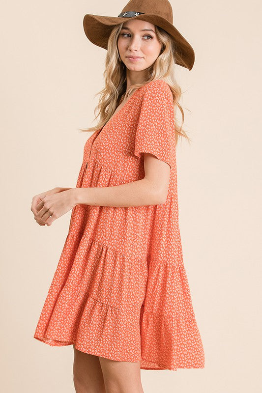 Coral button down ruffle dress