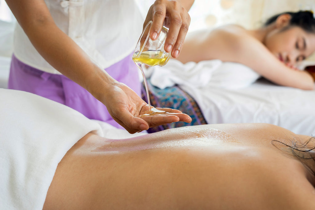 Massage for pain relief - White Flower Oil