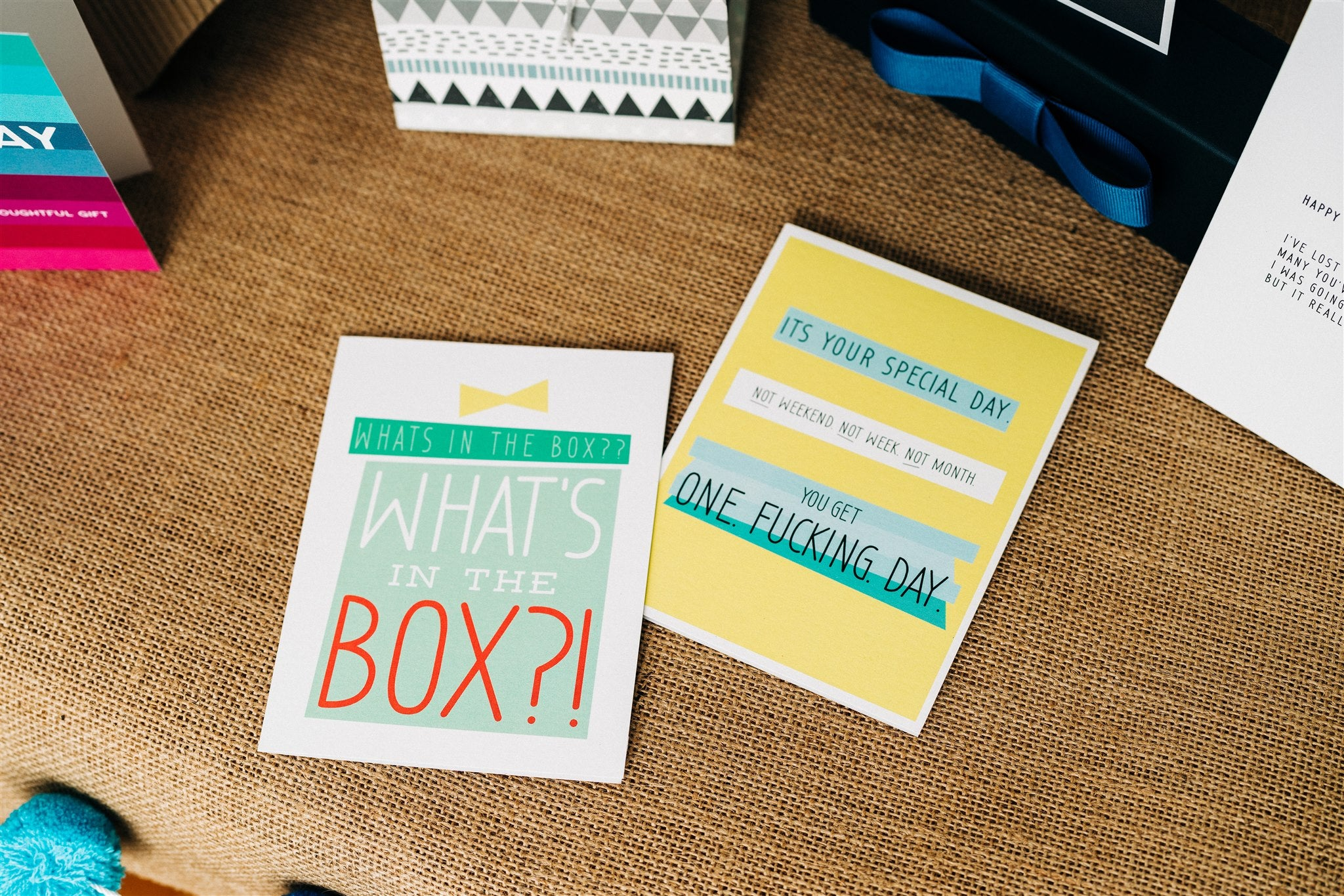 """Sarcastic and funny birthday greeting cards that read """"What's in the box?!"""" and """"You get one fucking day""""."""