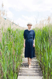 walking into the wild with long blue shirt dress