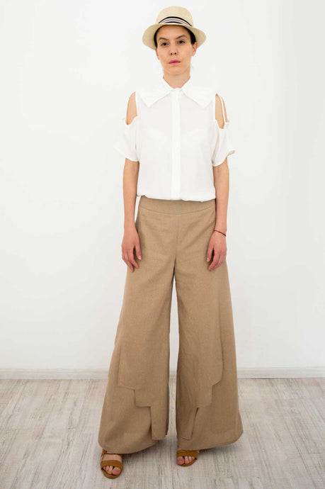 beige linen pants and white shirt