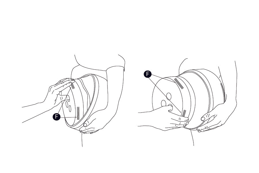 Step 1: Slide safety lock closed. Hug pail close to body with one arm. Place thumb in hole and fingers on textured grip (F) on bottom side of pail. Pull bottom away from top on an angle in a downward direction to expand  middle of pail. Rotate pail and repeat to fully open.