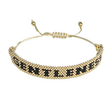 Load image into Gallery viewer, Gentleness Gold and Black beaded adjustable bracelet.