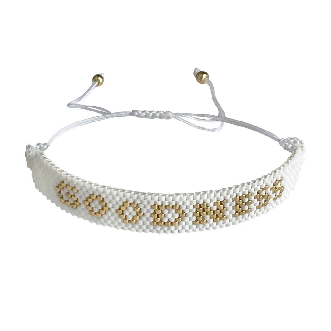 Goodness Gold and White beaded adjustable bracelet.