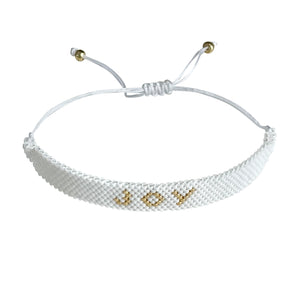 Joy Gold and White beaded adjustable bracelet.