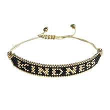 Load image into Gallery viewer, Kindness Gold and Black beaded adjustable bracelet.