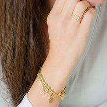 Load image into Gallery viewer, 14k gold-plated vine and leaf bracelet and nude color enamel with disc charm with cross