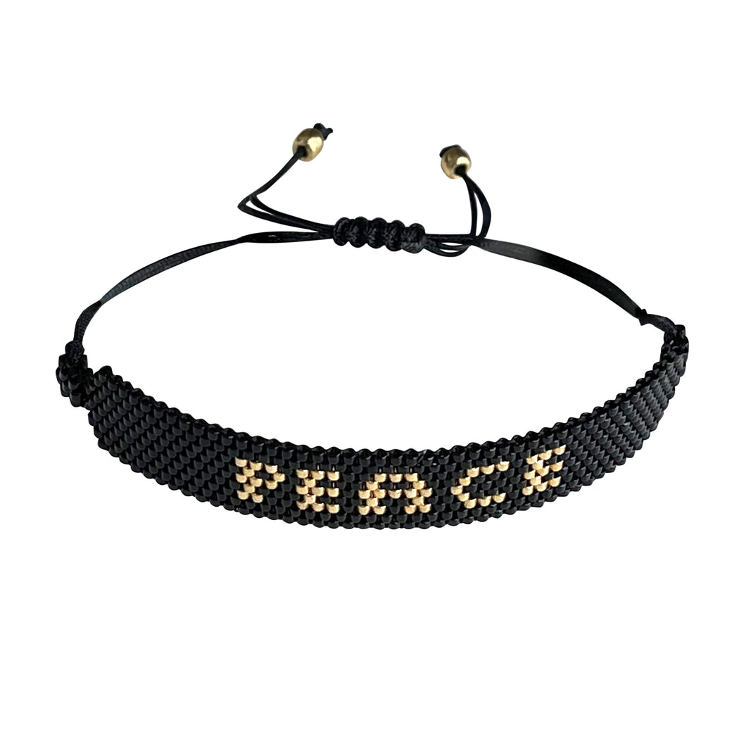 Peace Gold and Black beaded adjustable bracelet.