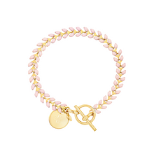 Load image into Gallery viewer, Vine gold-plated bracelet with pink enamel, toggle, and disc charm with cross