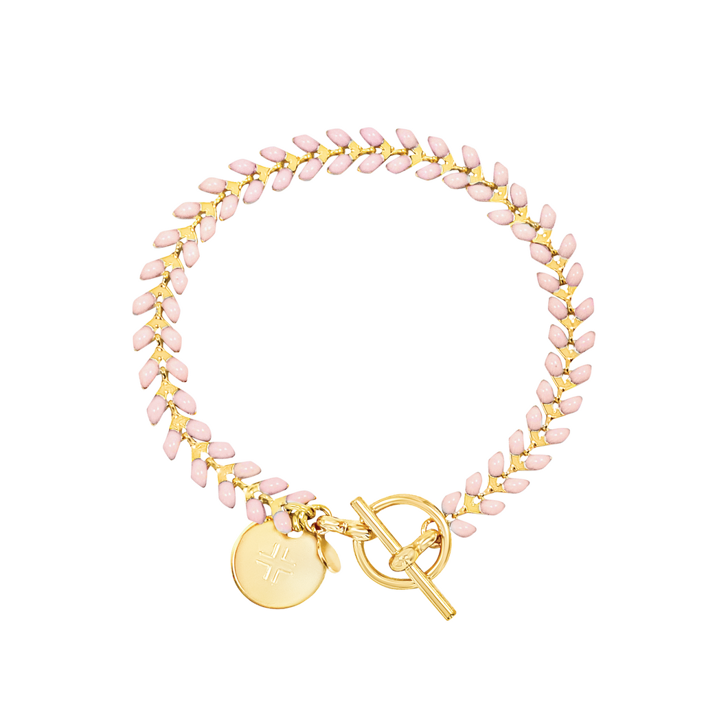 Vine gold-plated bracelet with pink enamel, toggle, and disc charm with cross