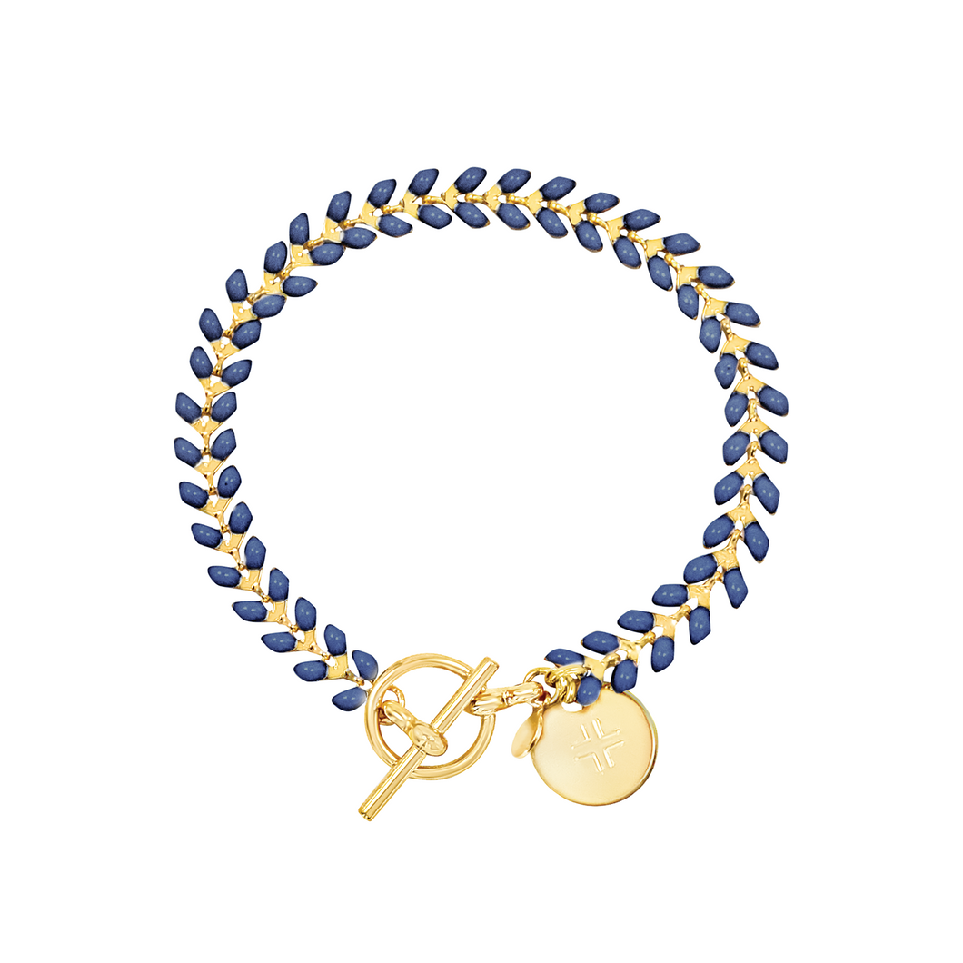 Vine gold-plated bracelet with navy enamel, toggle, and disc charm with cross