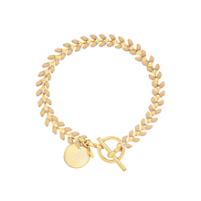 Load image into Gallery viewer, Vine gold-plated bracelet with nude color enamel, toggle, and disc charm with cross