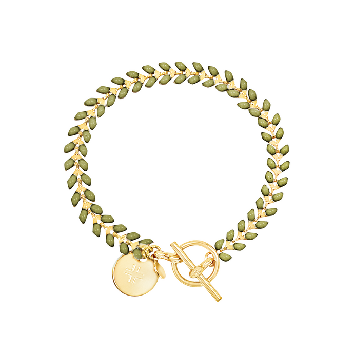 Vine gold-plated bracelet with olive green enamel, toggle, and disc charm with cross