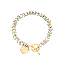 Load image into Gallery viewer, Vine gold-plated bracelet with slate gray enamel, toggle, and disc charm with cross