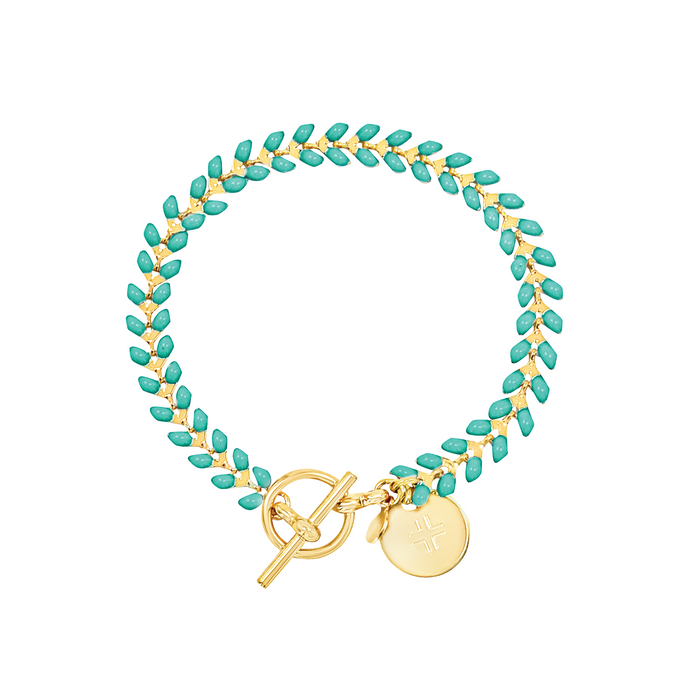 Vine gold-plated bracelet with turquoise enamel, toggle, and disc charm with cross