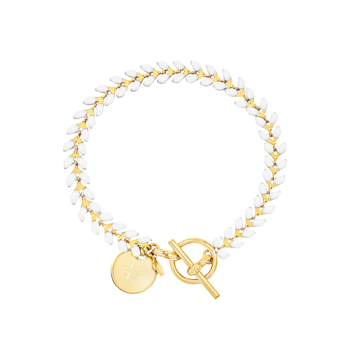 Vine gold-plated bracelet with white enamel, toggle, and disc charm with cross
