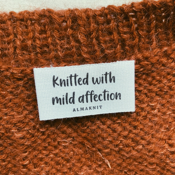 """Knitted with mild affection"" label"