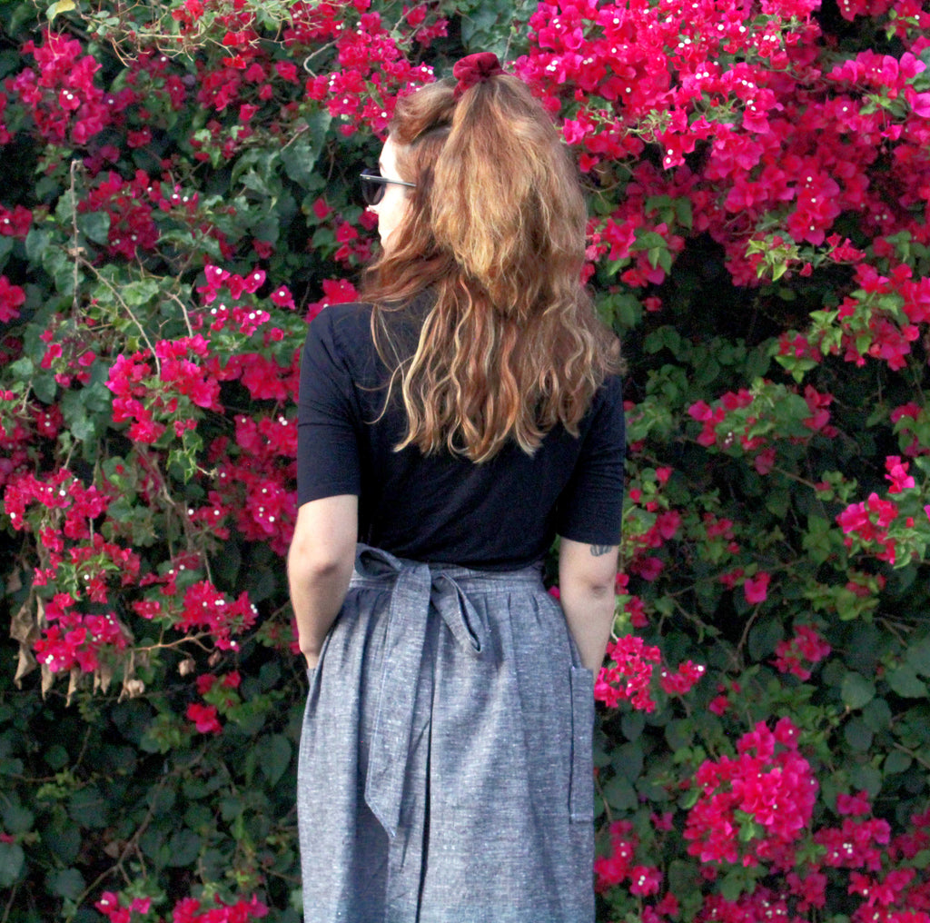 The Jupiter Wrap Skirt: Patch pockets + midi length hem (back view)