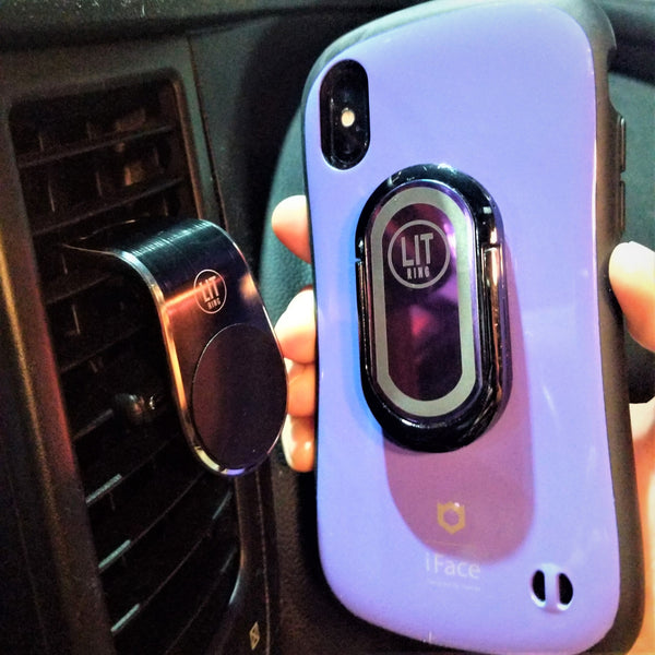 Purple LIT Ring attached to purple phone and demonstrating magnetic car mount