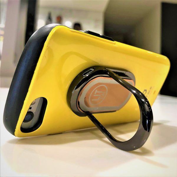 Copper LIT Ring using kickstand and attached to yellow phone