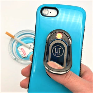 Blue LIT Ring attached to blue phone over supreme ashtray with cigarette