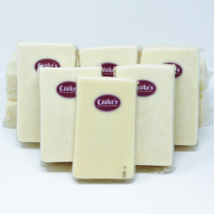 5 pre-sealed packages of Cooke's cheddar, each with the burgundy Cooke's logo.