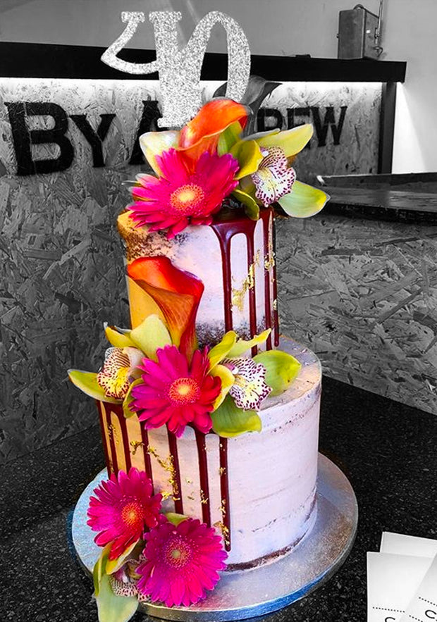 This cake is a 2 tier tall style cake (serving 50-60)