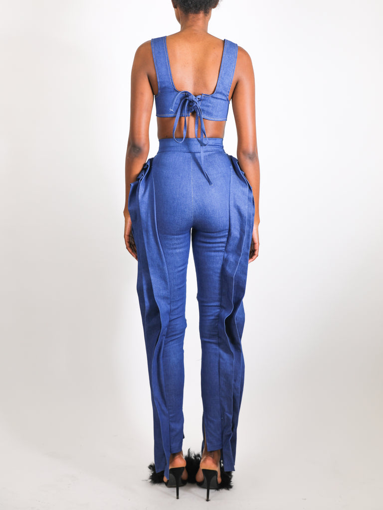 Model wears small Denim Pleat Pants by GrayScale (Back)
