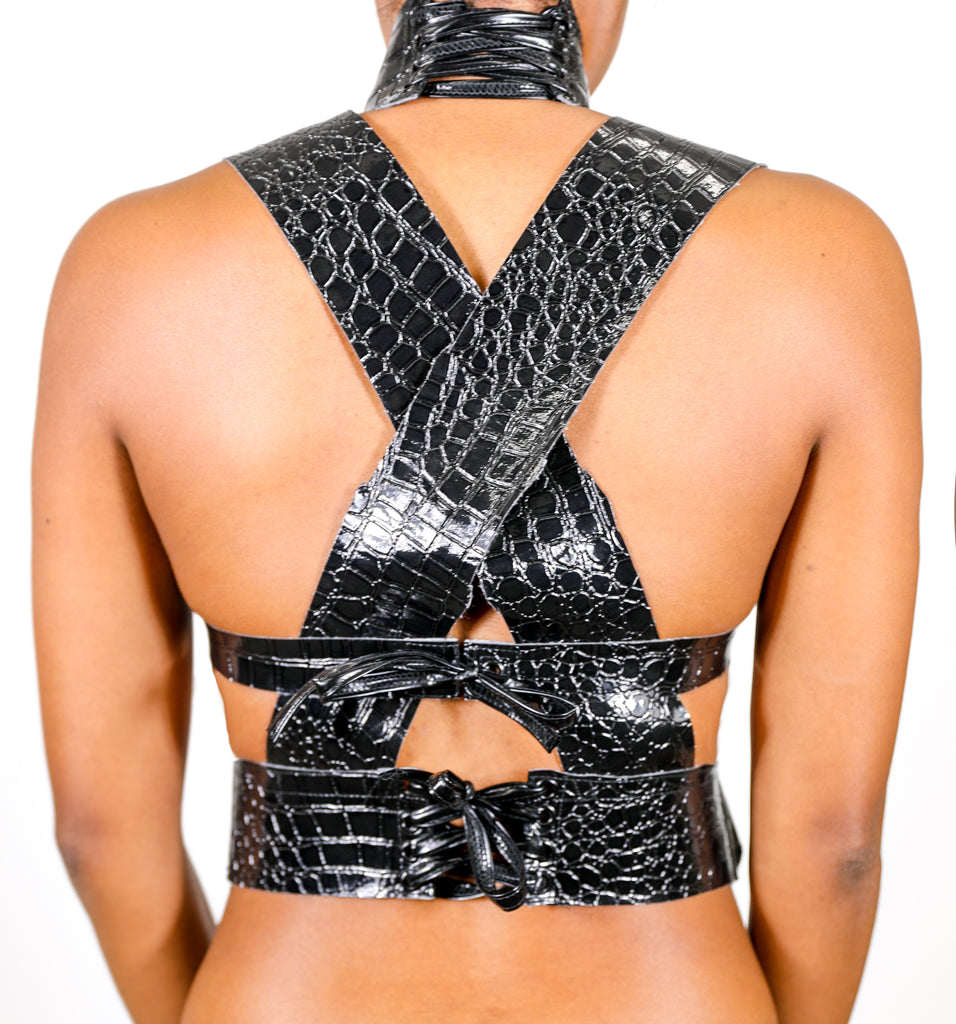 Model wears small Criss Cross Croc Top - Black by GrayScale (Back)