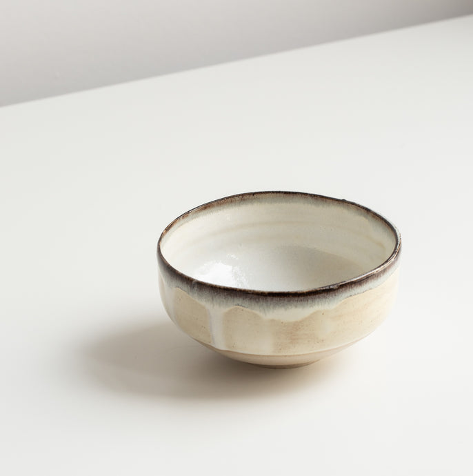 White bowl with black slib.