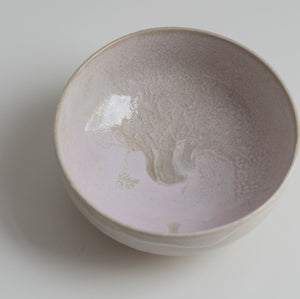 Pink bowl with white slib made of clay.
