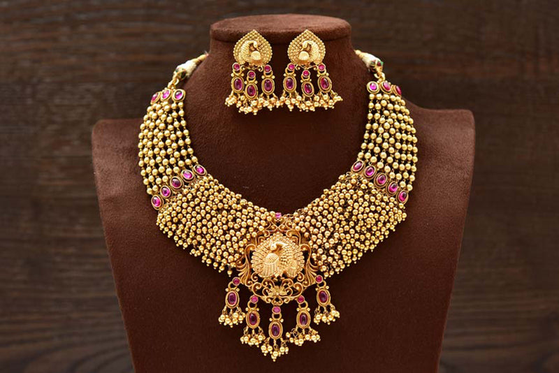 24K Gold Plated Intricately Handcrafted Antique Brass Jewellery Set with Peacock Engraved Along With Earrings