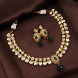 24K Gold Plated Intricately Handcrafted Green Enamel Jewellery Set Glided With Uncut Polki Kundans For Women