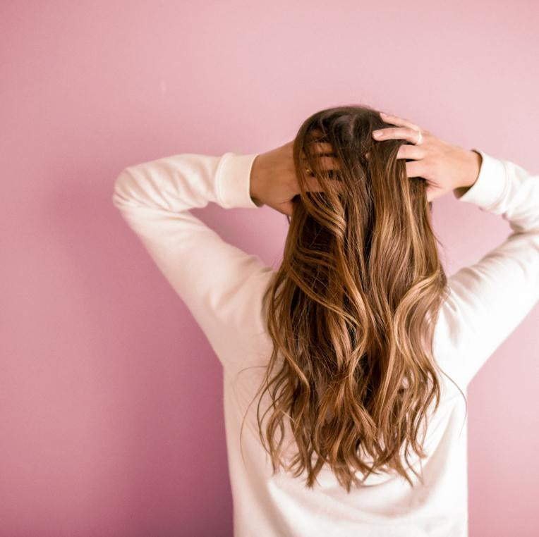 The benefits of air drying your hair