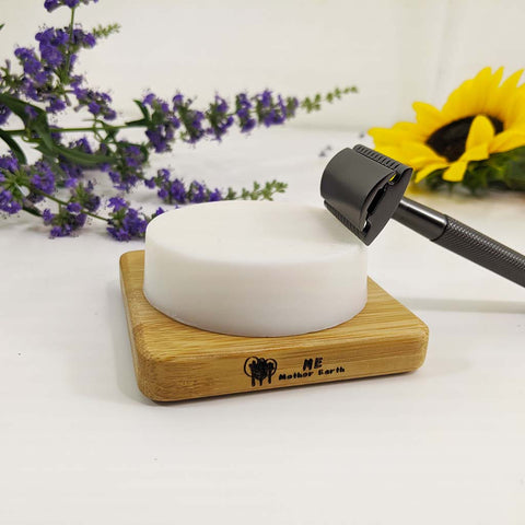 Shave soap on soap dish with razor