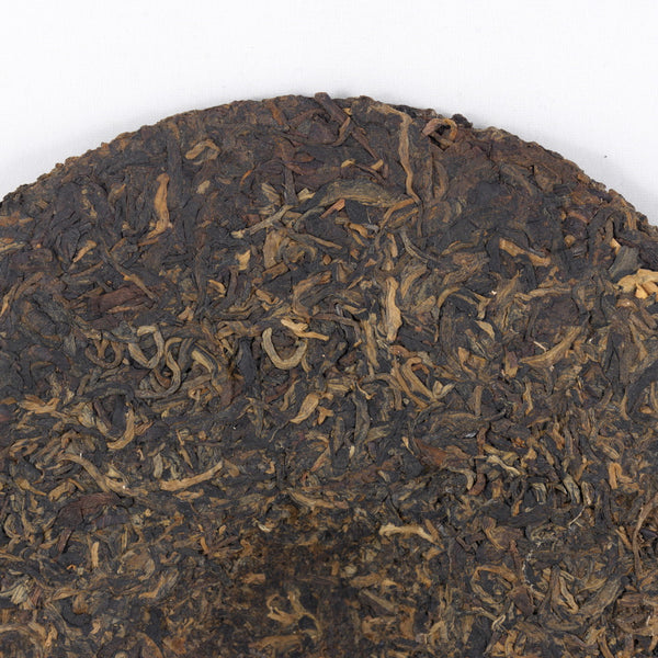 "Pu-Erh Tea Cake, ""Iron Mold"", Import/Export Corporation, 1990s (Raw/Sheng)"