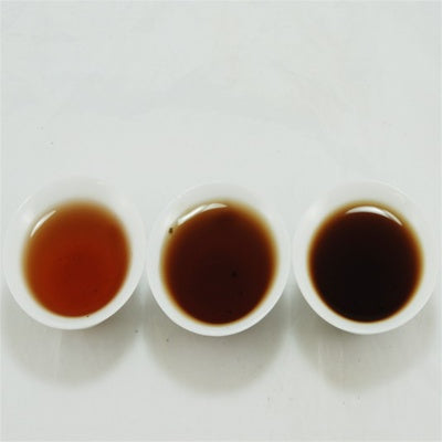 Pu-Erh Tea Cake Red Dayi 7262  Menghai Tea Factory, 2003 (Black/Shou)