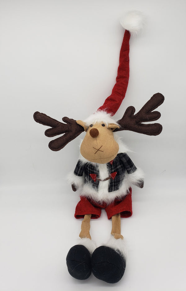Fluffy  sitting moose with a Santa hat, Christmas decoration plush, tabletop