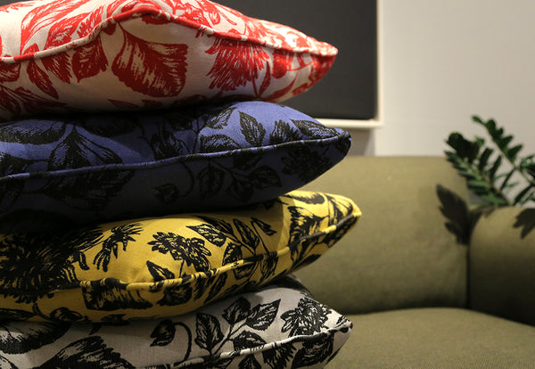 Colourful stack of Shaku upcycled silk cushion collection