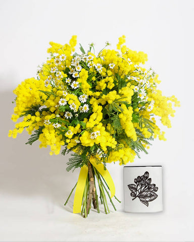 Yellow flowers and small jasmine candle