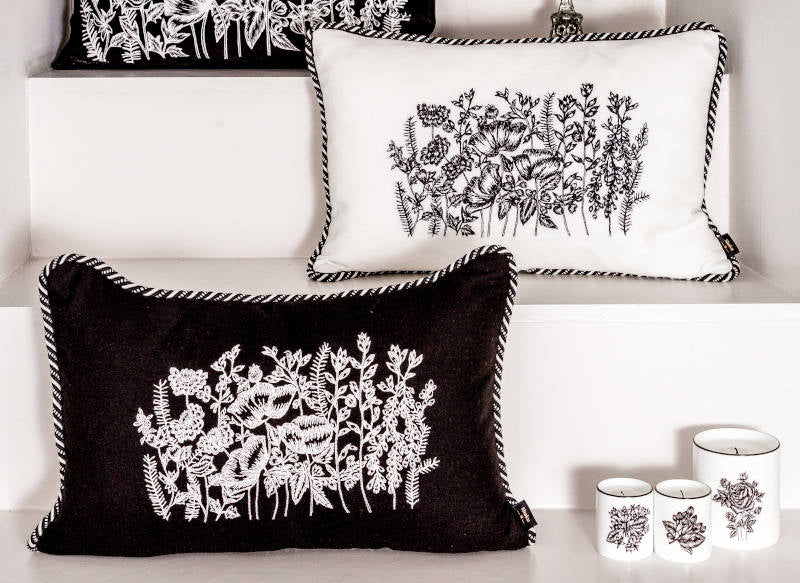 Embroidered linen cushions in black and white