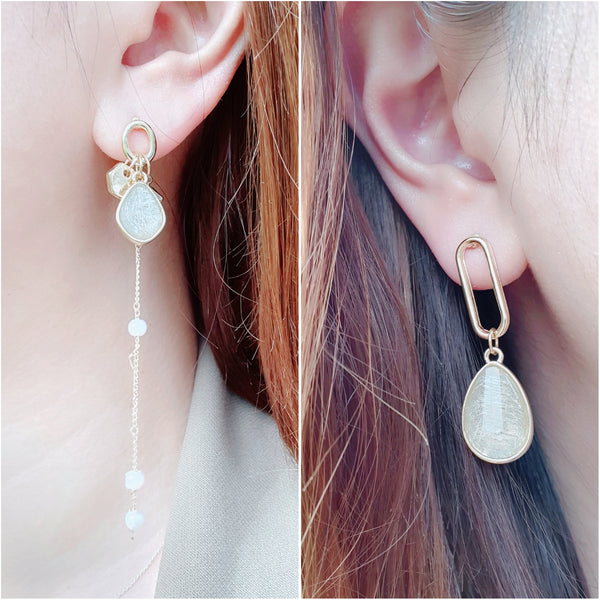 Mismatched dangling earrings