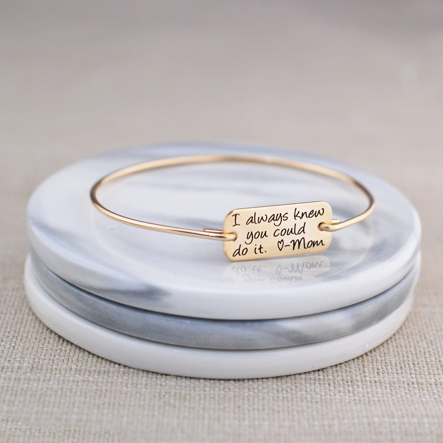Gold personalized bracelet engraved 'I always knew you could do it. - Mom