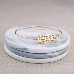 Gold personalized bracelet engraved 'I always knew you could do it. - Mom""